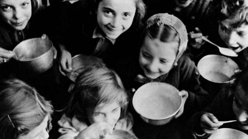 1951: Refugee children from the civil war areas in Ioannina, Greece wait for milk provided by UNICEF.